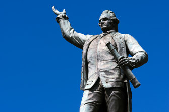 "Captain James Cook's statue, erected in 1879, still bears an inscription that reads ""Discovered this territory 1770."""
