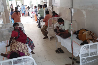 Patients at a hospital in Eluru, where more than 200 people have fallen ill with the mystery illness.