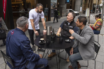 Customers having coffee in a former loading zone outside Soho Espresso on Pitt St in the Sydney CBD.