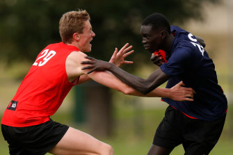 Andrew grapples with Toby Conway (left) during an AFL academy training session.