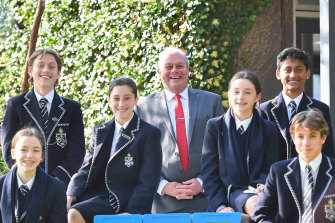 Mentone Grammar principal Mal Cater and Year 8 students.