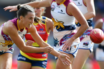Jade Ellenger of Brisbane handballs during her side's grand final win over Adelaide last month.