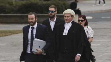 Alister Spong (second from left), joined by his wife, solicitor Jacob Robertson (left) and barrister Steven Whybrow (right)  arrives at the ACT Supreme Court for the trial over his friend's death at Summernats.