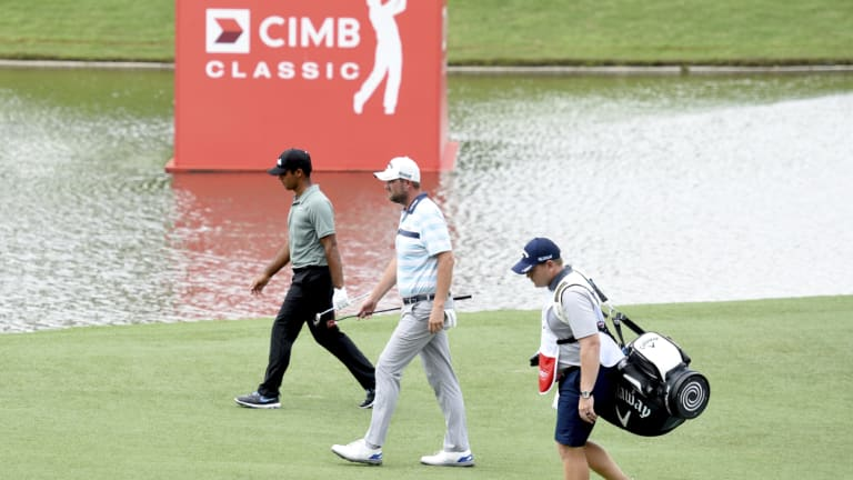 Walk in the park: The 34-year-old Australian from Warrnambool (centre) shot into the lead with four birdies in the first five holes on day two.