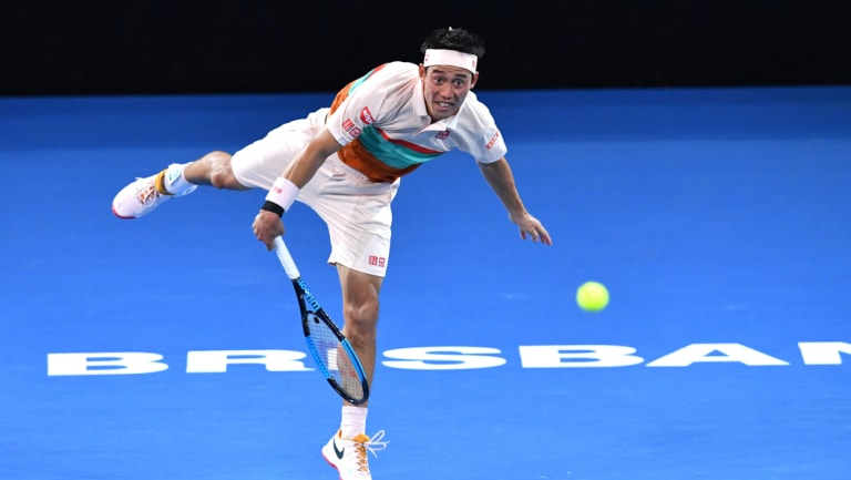 Kei Nishikori of Japan in action against Daniil Medvedev of Russia.