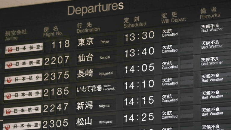 A flight information board shows the cancellation of flights at Osaka airport, on Tuesday.