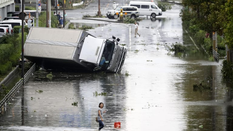An overturned truck on a flooded road following a powerful typhoon in Osaka, western Japan on September 4.