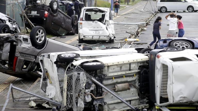 Overturned cars are seen on street following powerful typhoon Jebi in Osaka, western Japan.
