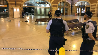 Police officers at Central Station where a police officer was stabbed in the back.