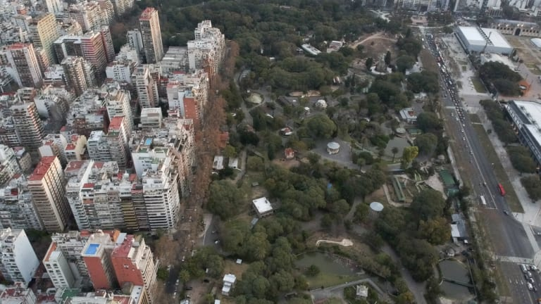 An areal view of the Eco Park in Buenos Aires, which has become surrounded by a sprawling urban zone of busy avenues with honking buses and screeching cars near the animal cages.