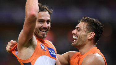 Running riot: Jeremy Finlayson, left, celebrates kicking a major with Stephen Coniglio.