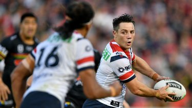 Calling for calm: Roosters halfback Cooper Cronk looks to put Sitili Tupouniua into a hole on Sunday.