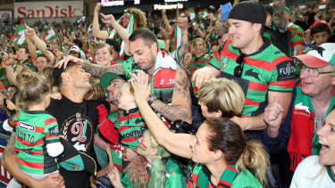 Crowning glory: Sutton with Rabbitohs fans after their 2014 triumph.