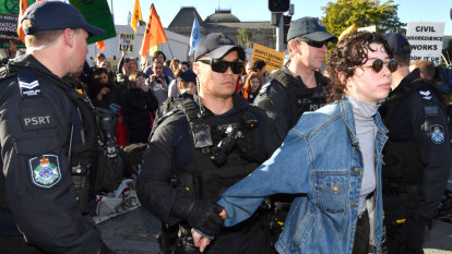 Protesters vow more disruption to come as more than 70 arrested in Brisbane