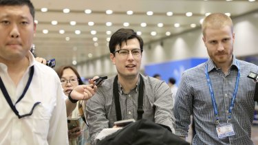 Australian student Alek Sigley smiles as he arrives at the airport in Beijing on Thursday.