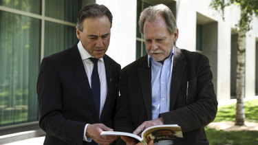 Health Minister Greg Hunt with Ken Fleming, who has written a book about his son Jack, who died of a brain tumor.