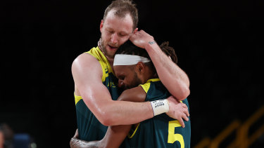 At last: Joe Ingles holds Patty Mills tight after the Boomers' emotion-laden win over Slovenia to claim bronze.
