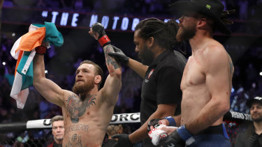 Fame and fortune: 'Notorious' Conor McGregor celebrates his first round TKO victory against Donald Cerrone during UFC246 in Las Vegas.