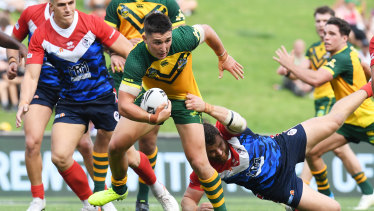 Junior Kangaroos man of the match Victor Radley busts a tackle on Friday.