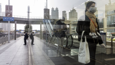 Passengers leave a subway station in Shanghai on Thursday.