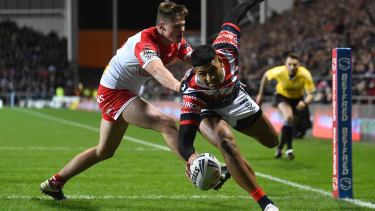 Daniel Tupou scores the Roosters' opening try.