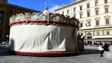 A merry-go-round is closed in Piazza della Repubblica Square, in Florence, Italy.