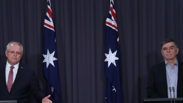 Prime Minister Scott Morrison with Chief Medical Officer Brendan Murphy on Sunday night.