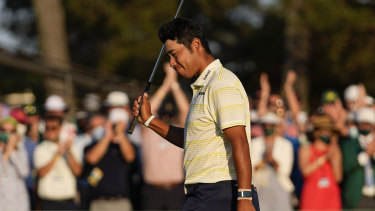 Hideki Matsuyama walks off the 18th green.