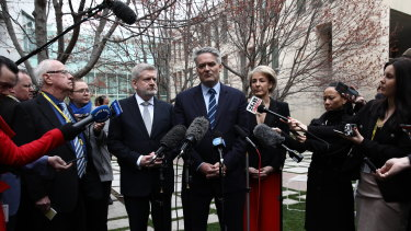Mitch Fifield, Mathias Cormann and Michaelia Cash announcing their resignation to the media on Thursday.