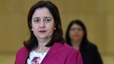 Premier Annastacia Palaszczuk announcing students' return to school with Education Minister Grace Grace (background).