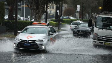 Heavy rain in Sydney resulted in flooding at O'Riordan Street in Alexandria on Wednesday.