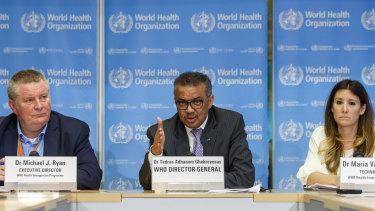 Director general Tedros Adhanom Ghebreyesus, centre, accompanied  by Dr Michael Ryan, left and Maria van Kerkhove, right, technical lead of WHO's Health Emergencies program.