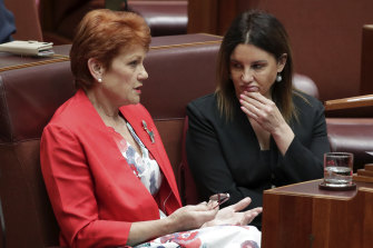 Senators Pauline Hanson and Jacqui Lambie in discussion during debate on Medevac.