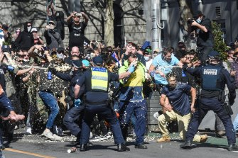 Police and anti-lockdown protests clash near Parliament House during a rally in August.