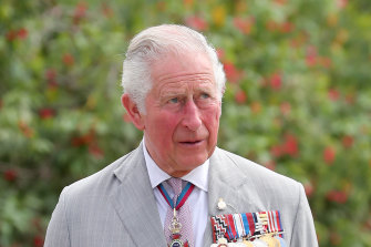 "Prince Charles says his father is ""all right"" in hospital."