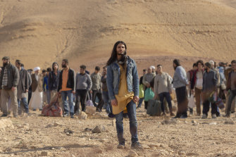 The man dubbed al-Masih (Mehdi Dehbi) leads his followers out of Syria to the Israeli border.
