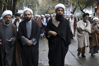 Clerics at a funeral for a Revolutionary Guard member who was killed in the protests.