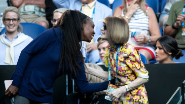 Anna Wintour (right) greets tennis champion Venus Williams in Serena Williams' player's box at the Australian Open.