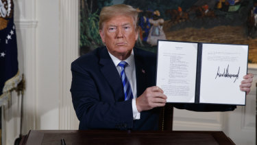 US President Donald Trump shows the signed Presidential Memorandum.