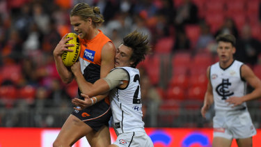 Take down: Giant forward Harry Himmelberg stands up to Carlton's defensive pressure.