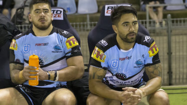 Shaun Johnson (right) has to watch on from the bench after being replaced at the business end of their defeat by Brisbane.