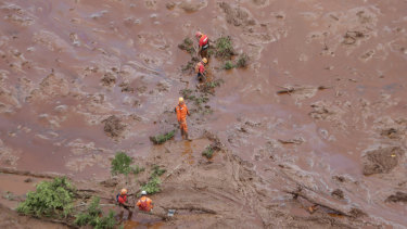 Rescue worker look for victims after a dam collapsed in Brumadinho, Brazil.