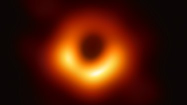 An image provided by the Event Horizon Telescope Collaboration shows the first image of a black hole, from the galaxy Messier 87, 55 million light-years from Earth in the constellation of Virgo.