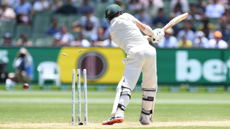 Straight through: Travis Head of Australia is bowled by Jasprit Bumrah in the first innings.