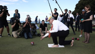 Prime Minister Scott Morrison shows off his barefoot bowls technique in Torquay.
