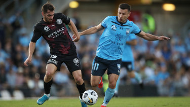 SYDNEY, AUSTRALIA - APRIL 10: Kosta Barbarouses of Sydney FC competes for the ball against Benjamin Garuccio of Melbourne City during the A-League match between Sydney FC and Melbourne City FC at Leichhardt Oval, on April 10, 2021, in Sydney, Australia. (Photo by Matt King/Getty Images)