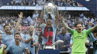 Triple treat: Manchester City capped off a sensational season in style.