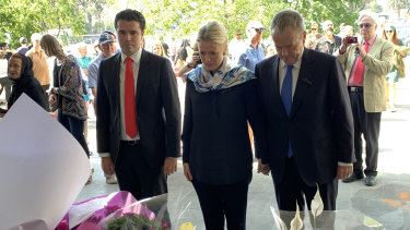 Tim Watts, Chloe Shorten and Bill Shorten lay flowers at a tribute to the victims of the Christchurch terror attack at the Australian Islamic Centre in Newport.
