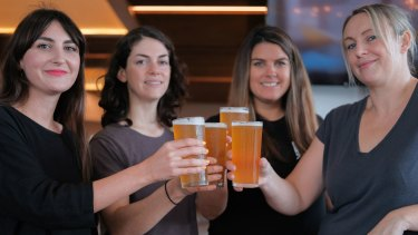 The girls from Gage Roads and the special beer brewed for International Women's Day this weekend.