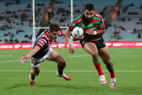 Souths winger Alex Johnston beats Kyle Flanagan to score one of his five tries.